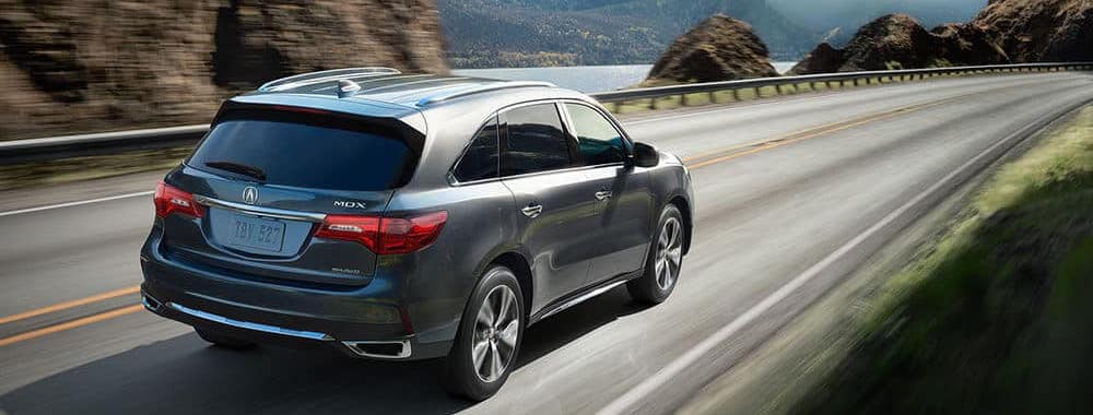 2018 silver Acura MDX driving down the highway