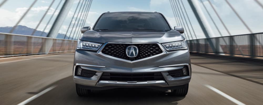 Front facing silver MDX driving on a highway