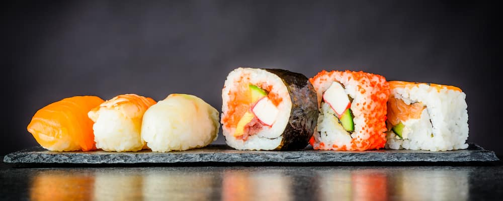 Sushi rolls against a dark background