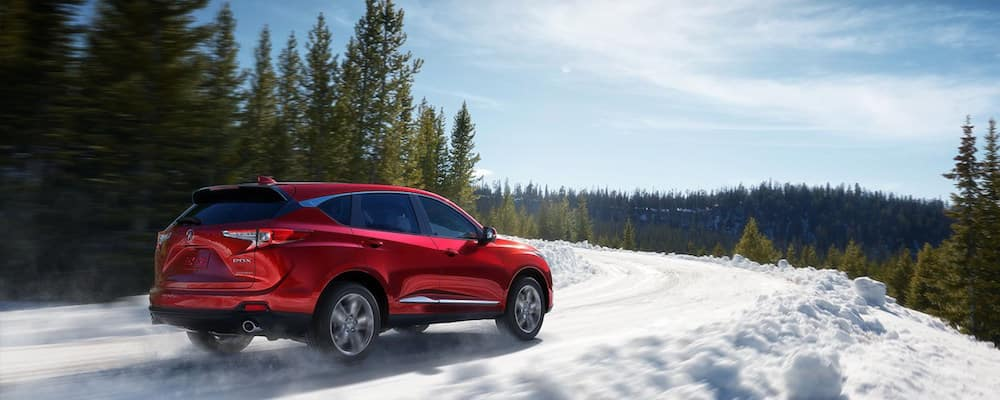 Red RDX driving on a snowy mountain