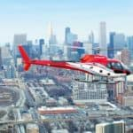 Helicopter flying over Chicago cityscape - photo from https://www.chicagohelicopterexperience.com
