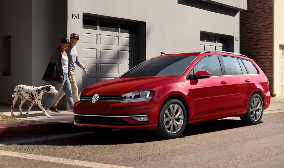 Tornado Red 2018 Volkswagen Golf SportWagen parked