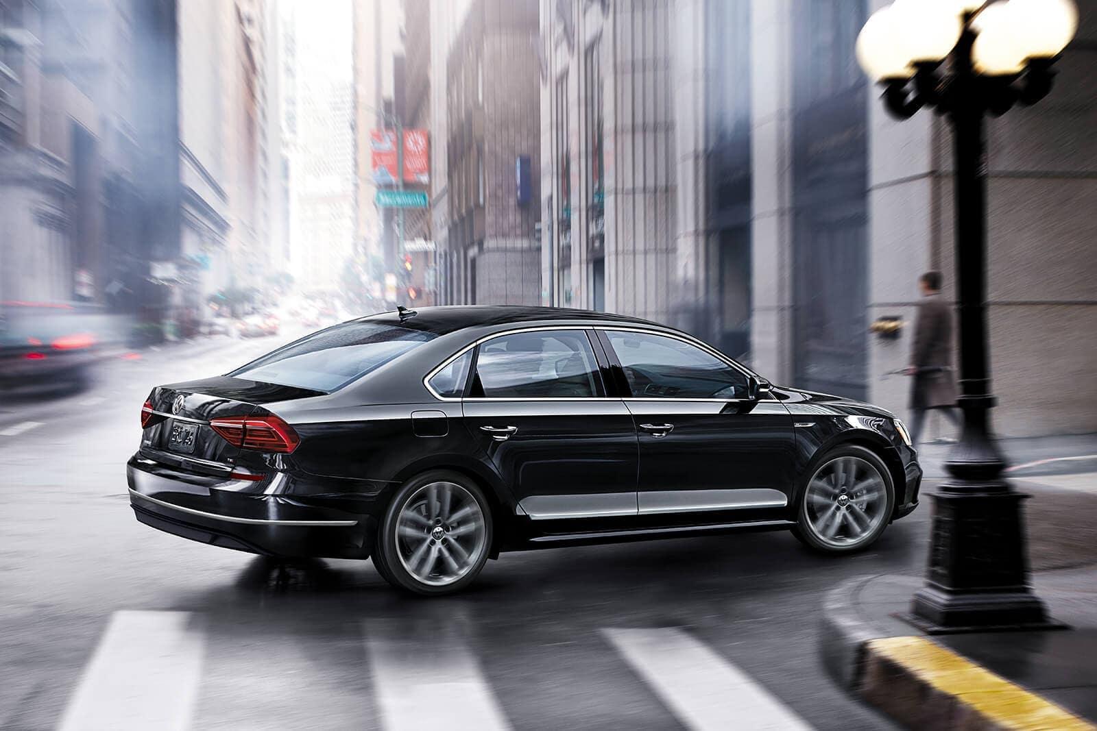 2019 Volkswagen Passat in black turning right