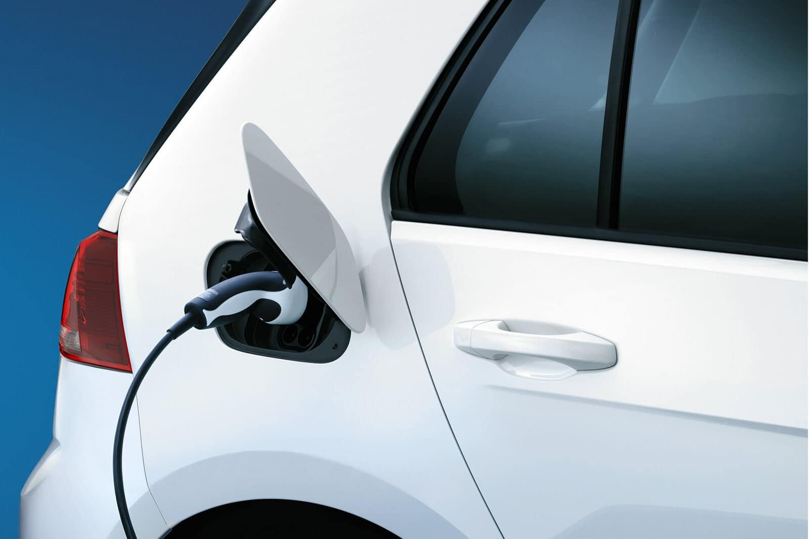 2019 Volkswagen eGolf in white plugged into charger