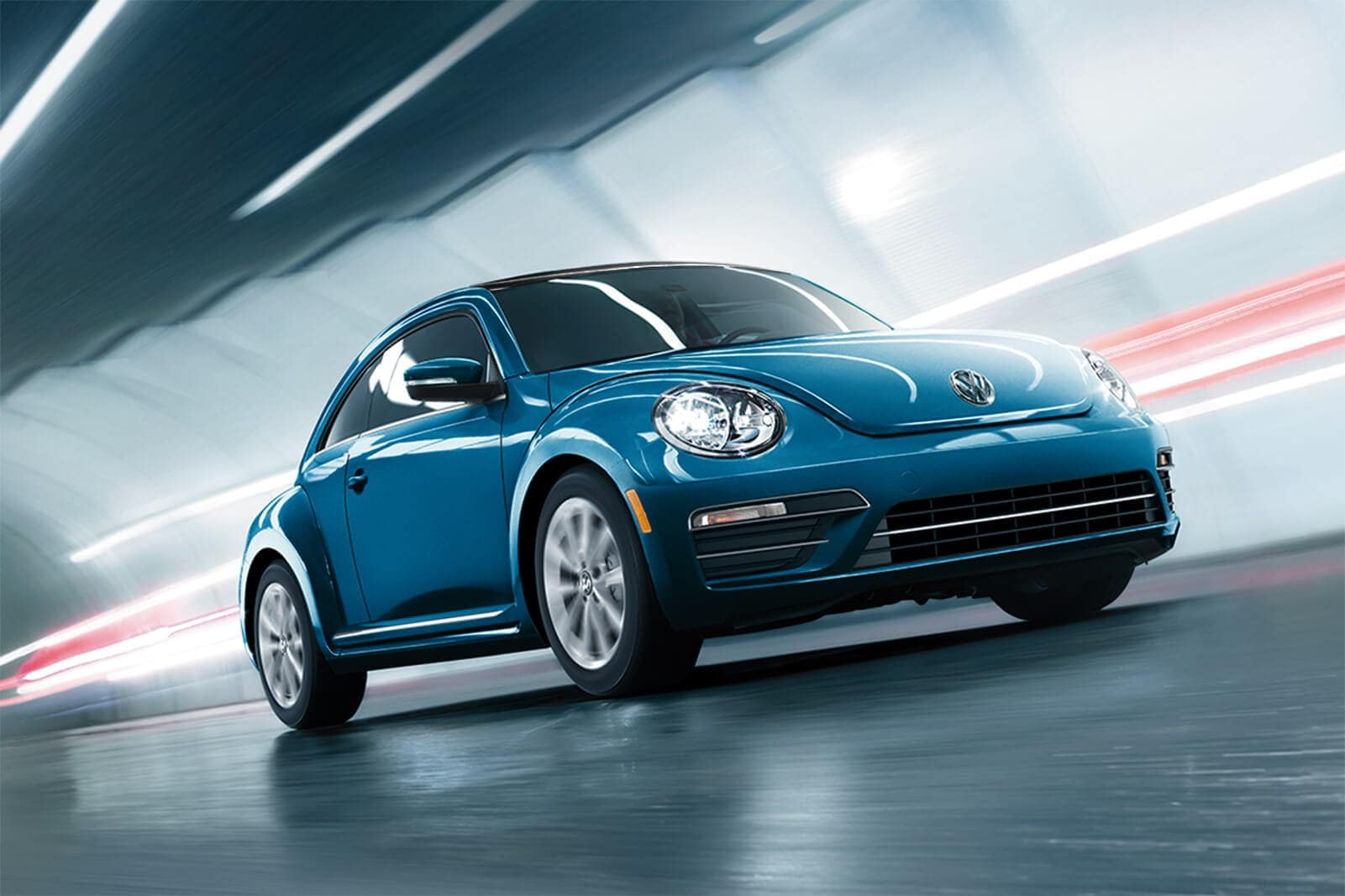 2019 Volkswagen Beetle final edition in blue driving down the road