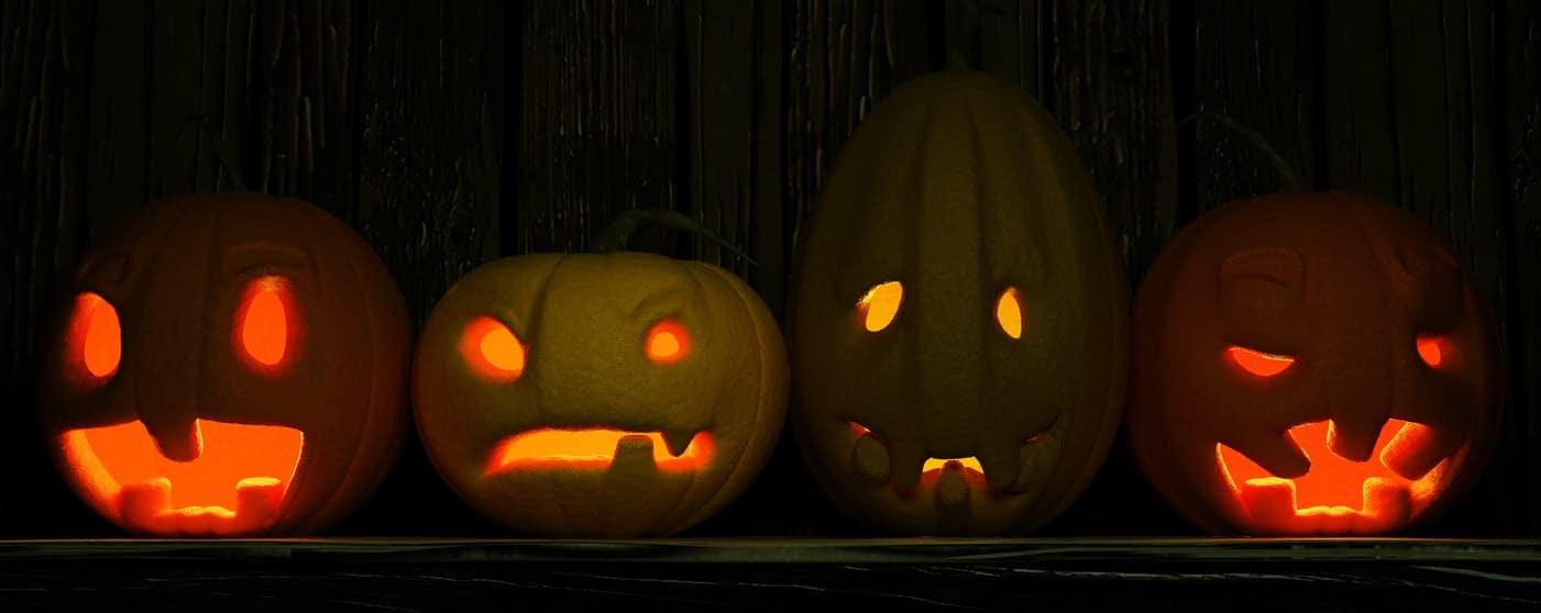 pumpkin jack o lanterns in a row