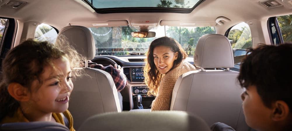 Family sitting inside VW Atlas