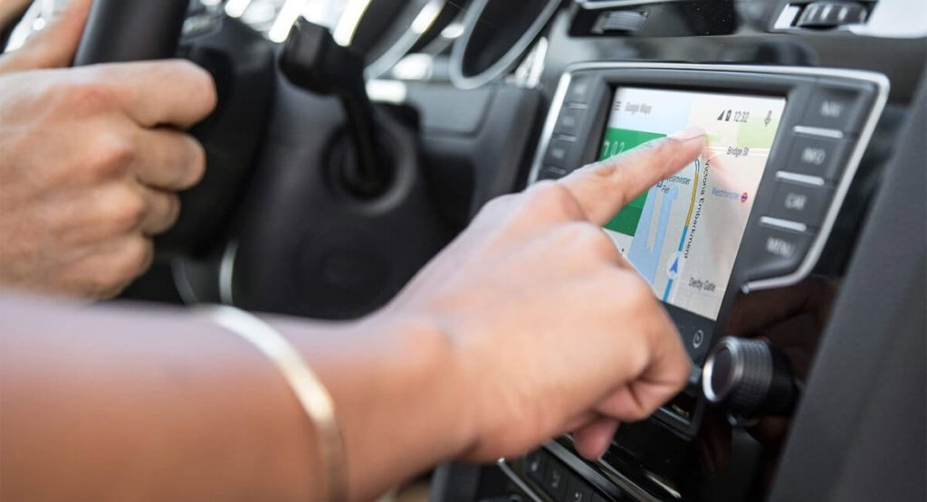 Hand pointing at touchscreen in VW Golf Sport