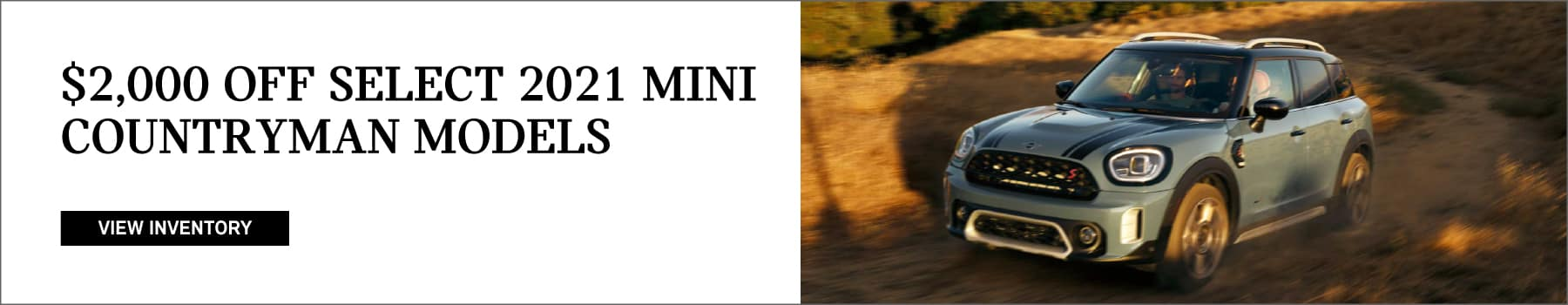 $2,000 off select 2021 MINI countryman models. Click to view inventory. Image shows a 2021 MINI Cooper S Countryman driving down a dirt road at sunset.