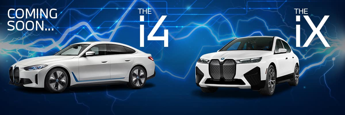 A new 2022 BMW i4 electric sedan next to a new 2022 BMW iX electric sports activity vehicle