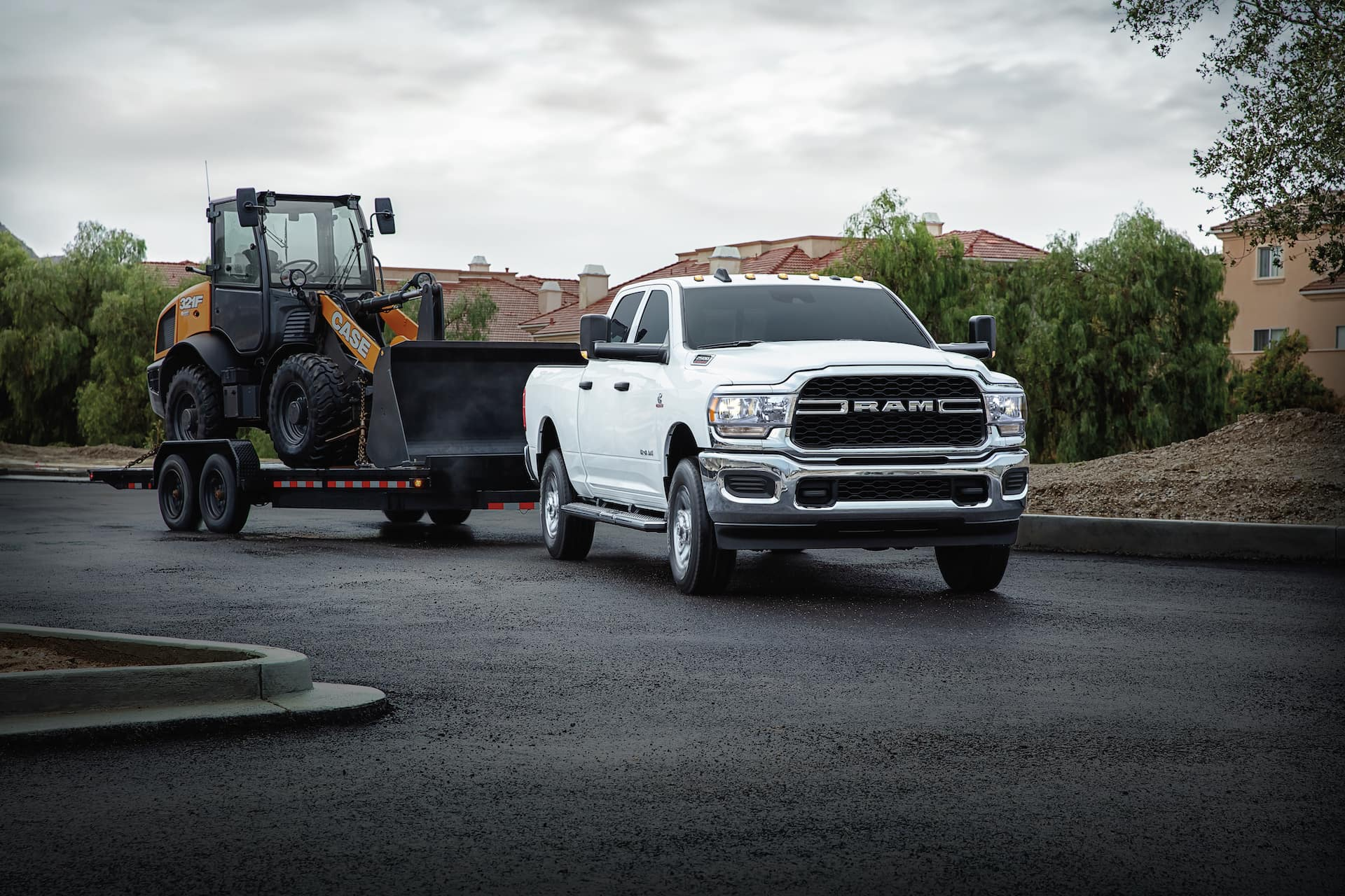 ram truck towing front loader