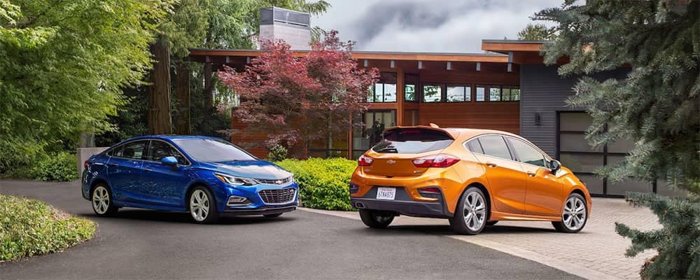2018 Chevrolet Cruze Models Parked Outside a Home