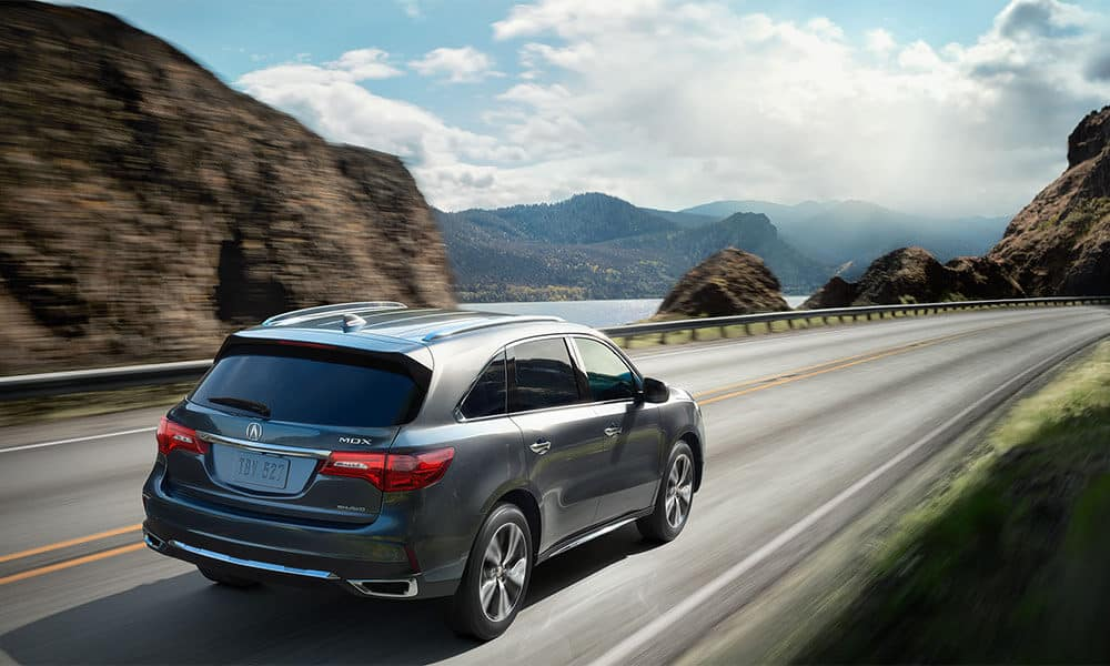 2018 Acura MDX rear view going down the highway