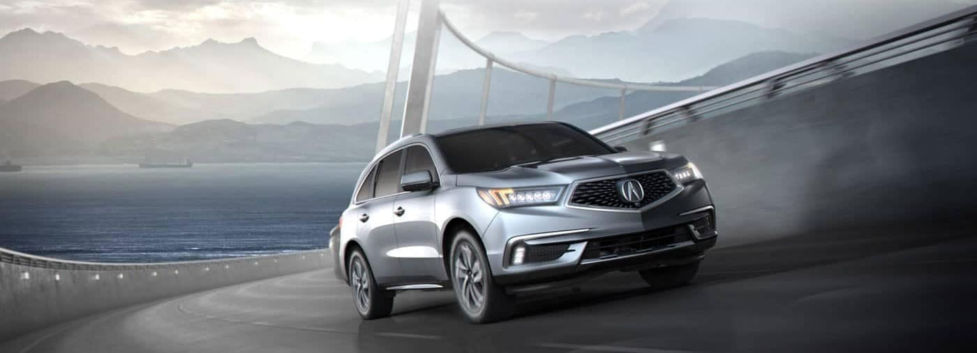 Acura MDX crossing a mysterious, fog-cloaked bridge
