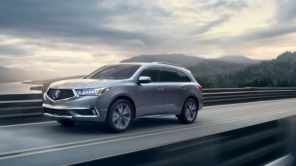 2019 Acura MDX on a highway at dusk