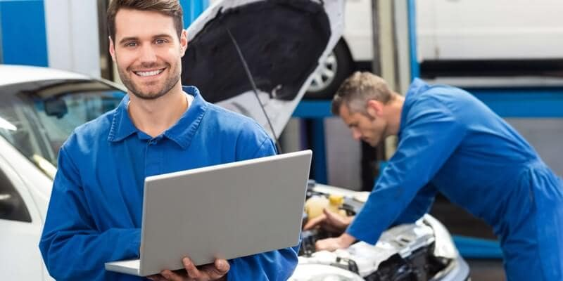 Mechanic Working on Computer