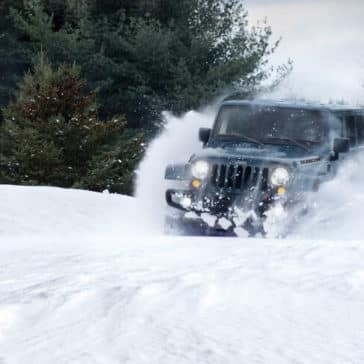 2018 Jeep Wrangler JK driving through snow