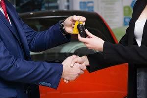 hand shake passing off keys to a new dodge