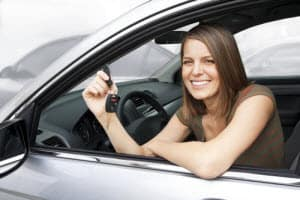 car buyer in car with keys