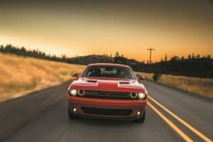 Red Dodge Challenger on the road