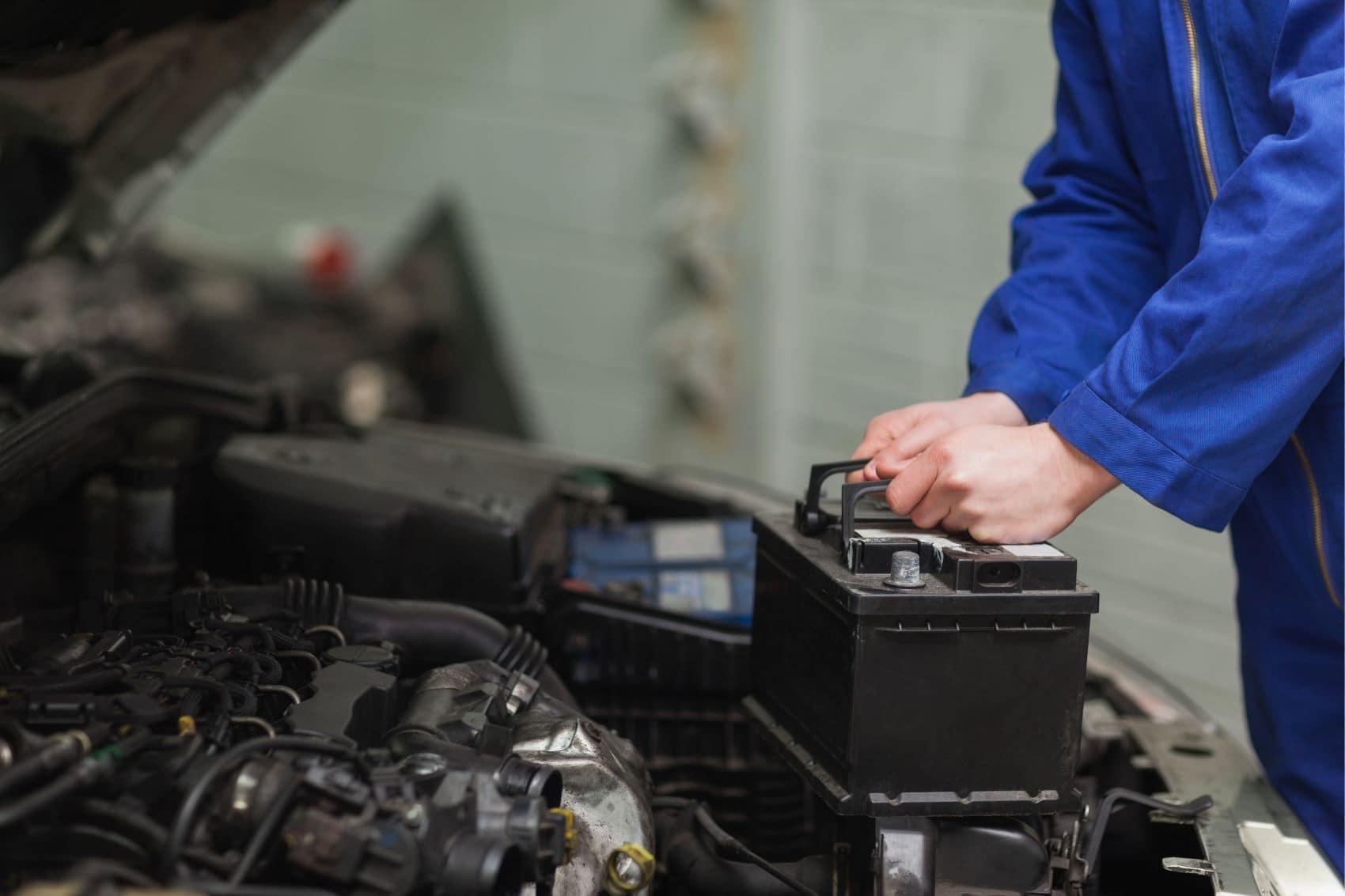 Mechanic installing a car battery