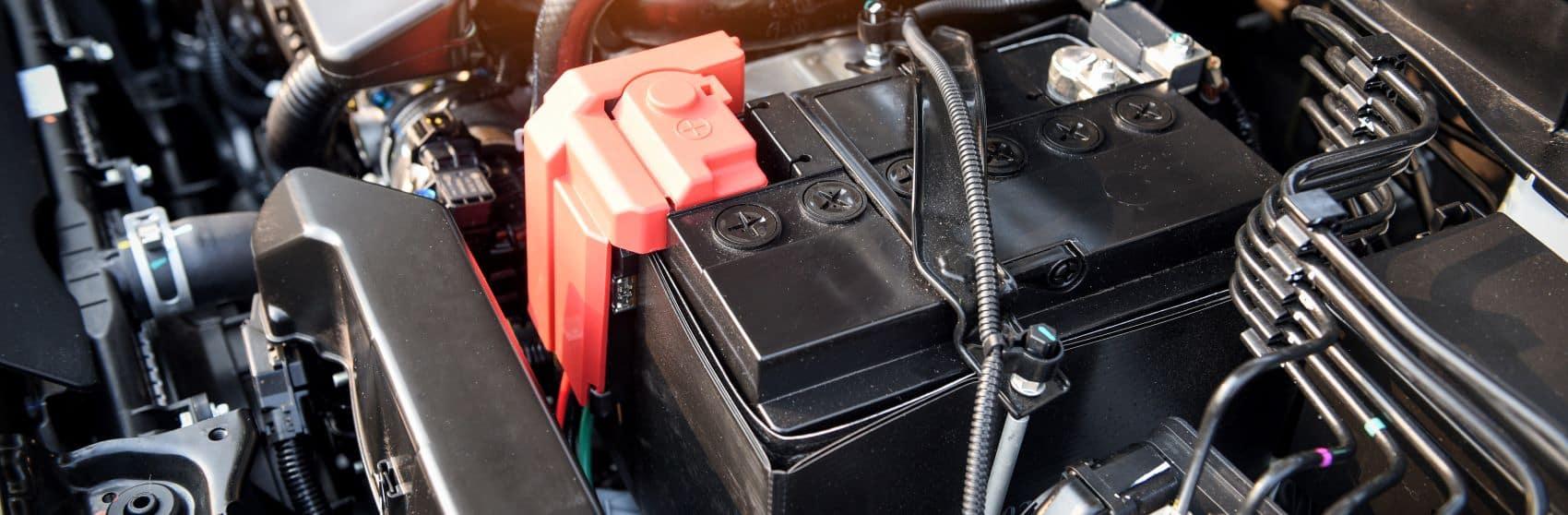 Car battery under the hood of a car