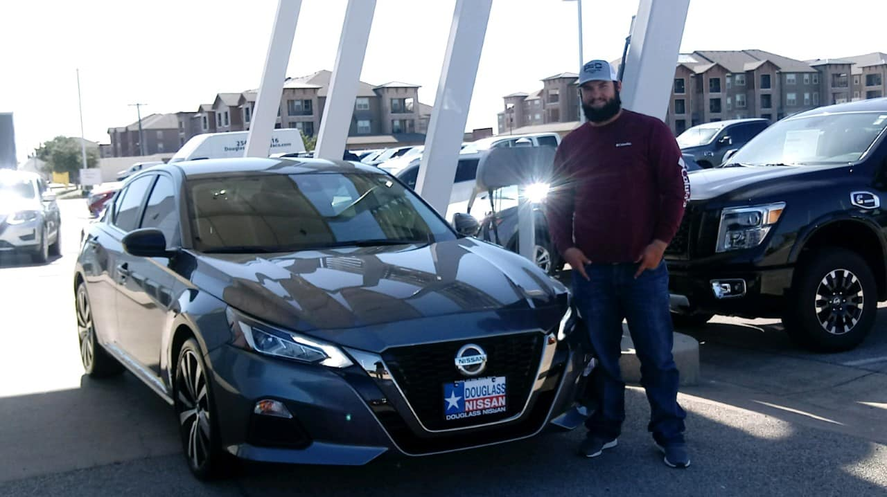 Happy customers buying a Nissan at Douglass Nissan of Waco