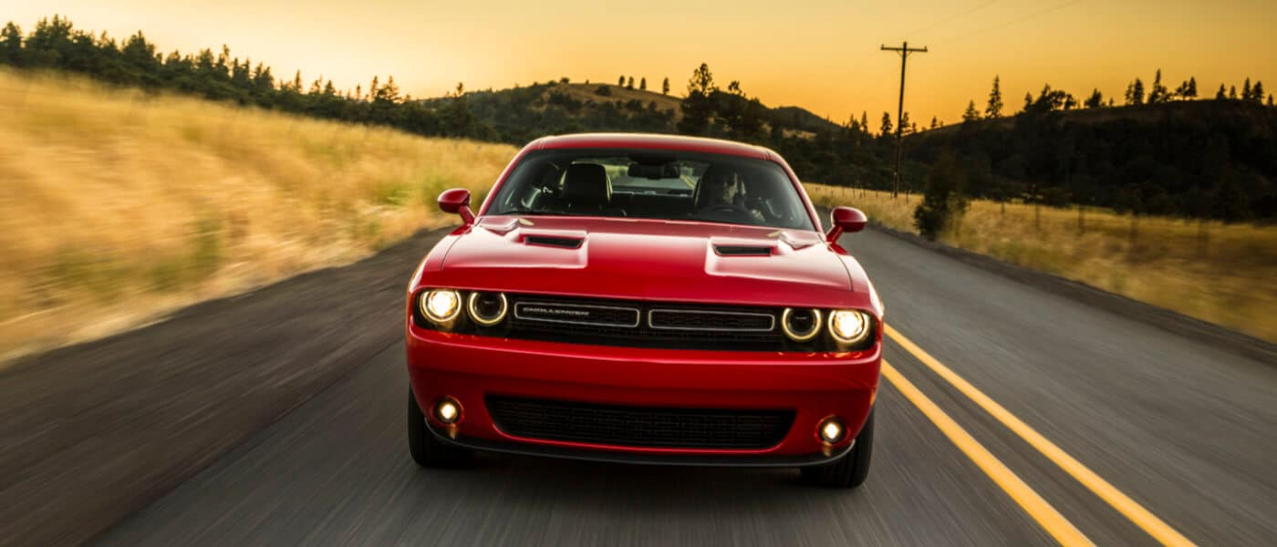 2019 Dodge Challenger exterior country road head on at sunset