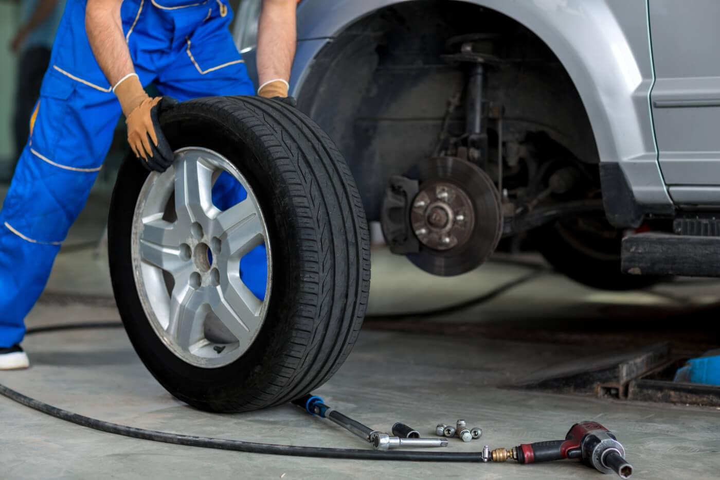 mechanic moving tire