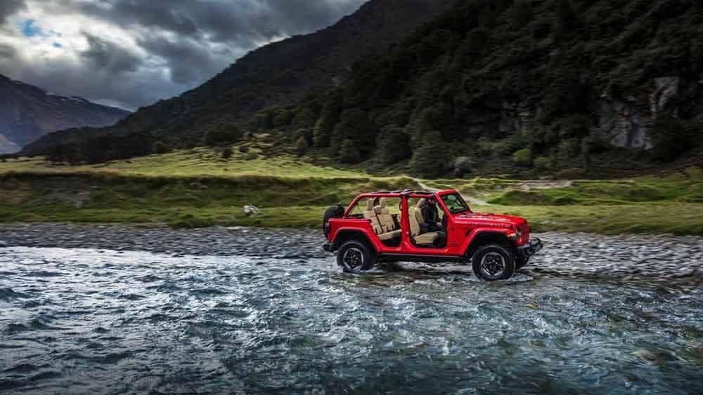 2018 Jeep Wrangler 4-door driving through the water