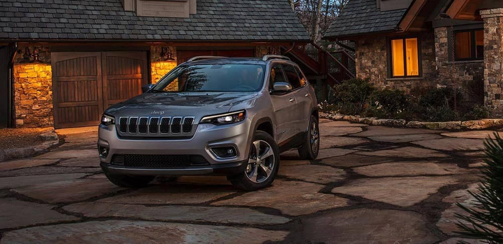 2019 Jeep Cherokee in front of a home
