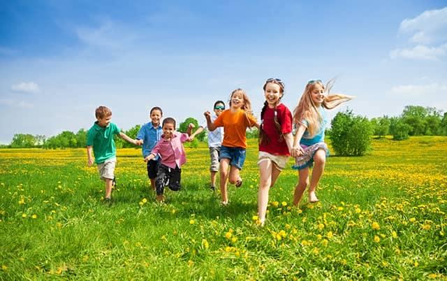 Kids Running in Grass