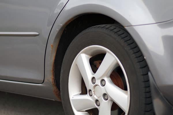 Side of Vehicle Visible Rust on Paint