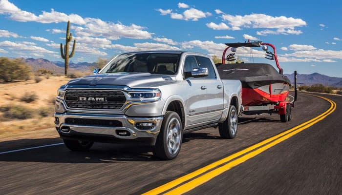2019 RAM 1500 Towing Boat on Road