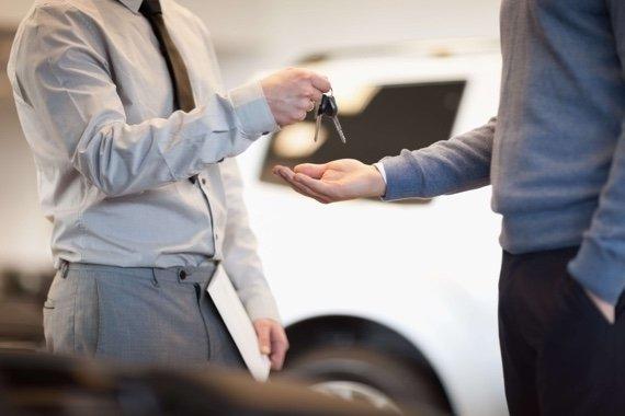 Man getting keys to his car