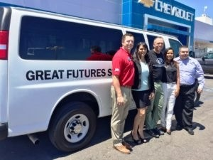 Boys and Girls Club receive van and school supplies from
