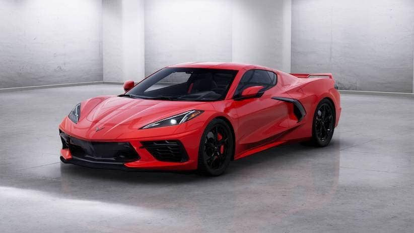 A red 2020 Chevy Corvette is facing left in a concrete room.