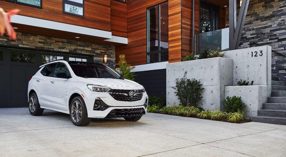 A white 2021 Buick Encore GX is parked in front of a house near Corsicana, TX.