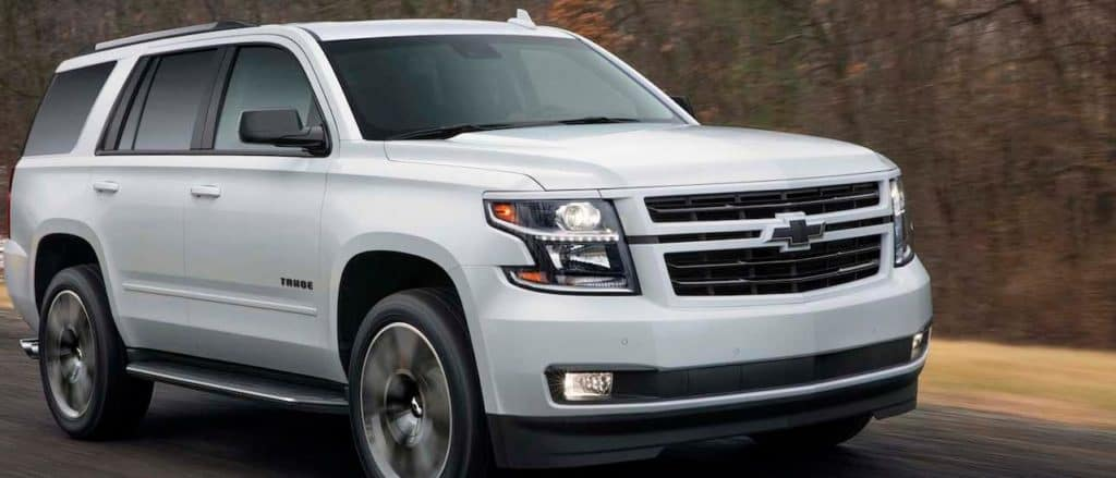 A white 2019 Chevy Tahoe out on a test drive.