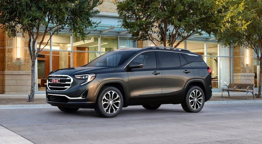 Grey 2018 GMC Terrain in front of a Texas storefront.