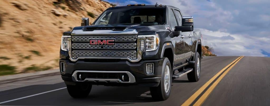 A black 2020 GMC Sierra 2500 is driving on a highway near Corsicana, TX.
