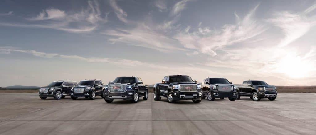 The 2019 GMC lineup is in black parked in an open cement area near Corsicana, TX.