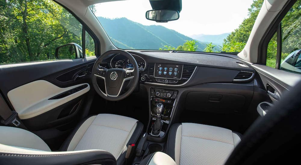 The black and white interior is shown on a 2021 Buick Encore.