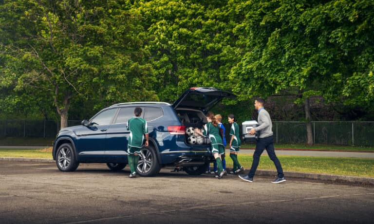 Children's soccer team loading up the trunk of a 2020 Volkswagen Atlas