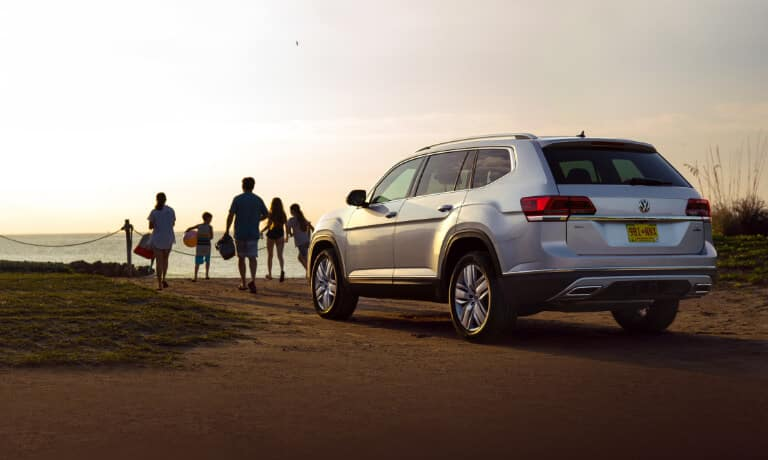 2020 Volkswagen Atlas parked while family goes to beach at sunset