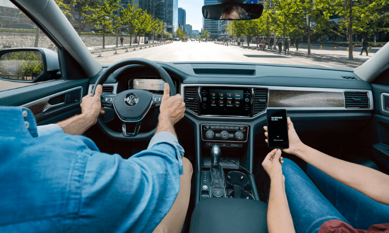 2020 Volkswagen Atlas woman connecting phone to infotainment system