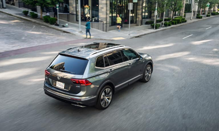 Gray 2020 Volkswagen Tiguan driving through an intersection