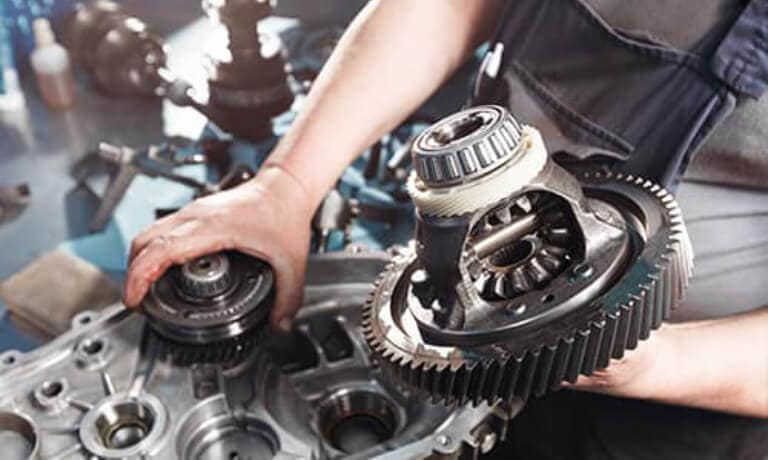 Technician removing gears from the crankcase