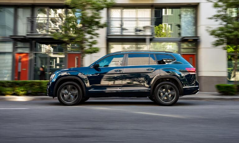 2020 Volkswagen Atlas side view driving through town