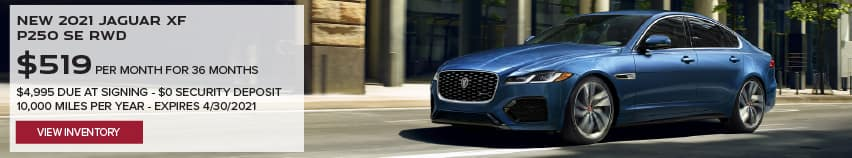 NEW 2021 JAGUAR XF P250 SE RWD. $519 PER MONTH. 36 MONTH LEASE TERM. $4,995 CASH DUE AT SIGNING. $0 SECURITY DEPOSIT. 10,000 MILES PER YEAR. EXCLUDES RETAILER FEES, TAXES, TITLE AND REGISTRATION FEES, PROCESSING FEE AND ANY EMISSION TESTING CHARGE. OFFER ENDS 4/30/2021. VIEW INVENTORY. BLUE JAGUAR XF DRIVING THROUGH CITY.